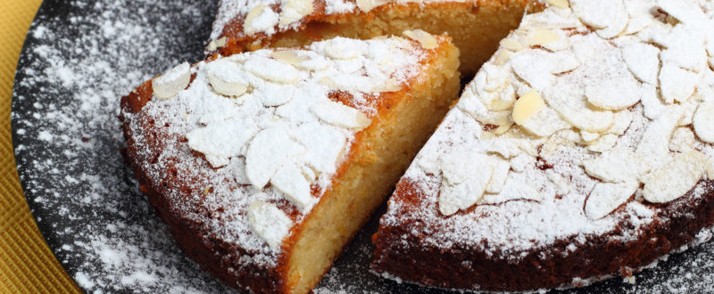 Almond torte with a slice cut out