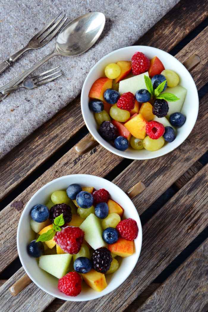 Freshly chopped fruit in bowls