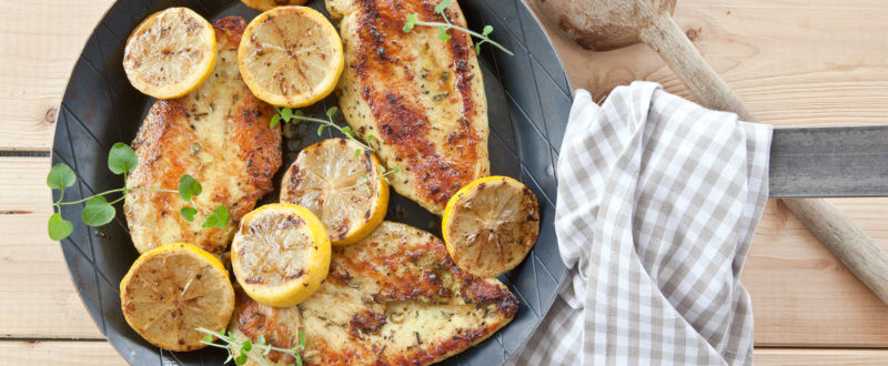 Lemon chicken in a traditional pan