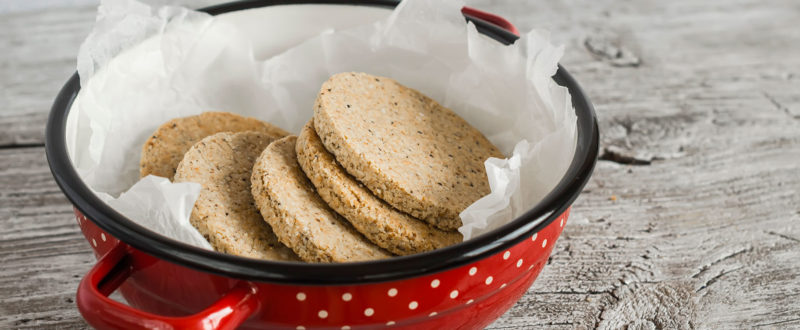 Stack of oat cakes in a red bowl