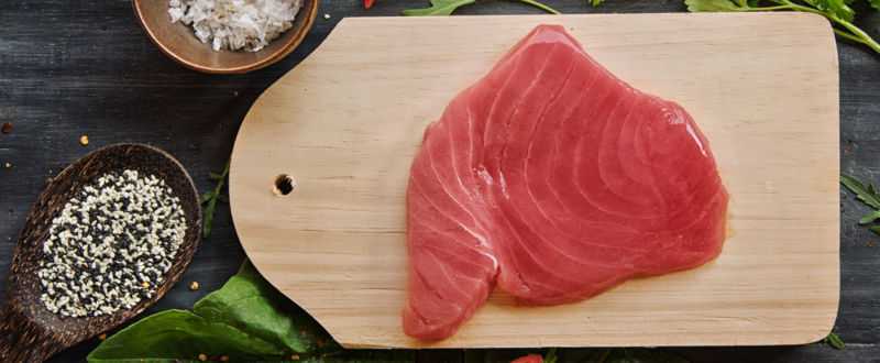 Raw tuna fillet with greens and chillies