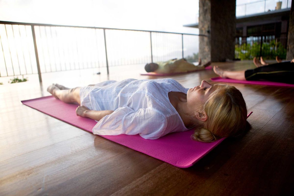 Woman resting in yoga class