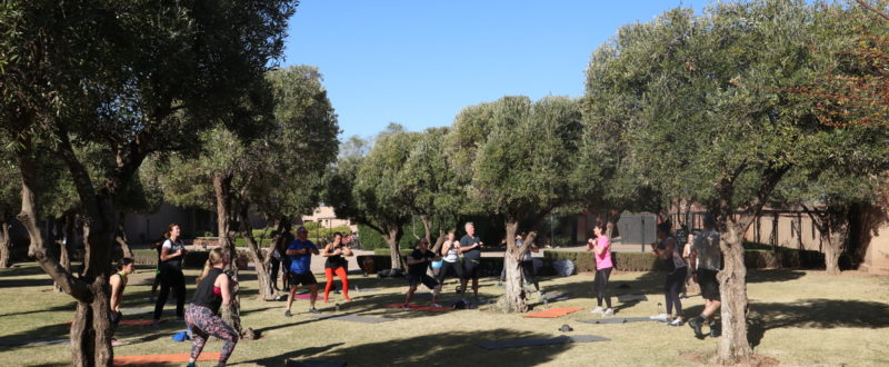 Group participating in a kettlebell work out in the sunshine in morocco
