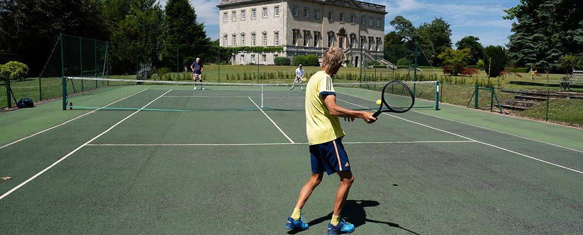Playing tennis outdoors at Kirtlington Park